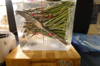 Bag of asparagus weighted with a butter knife